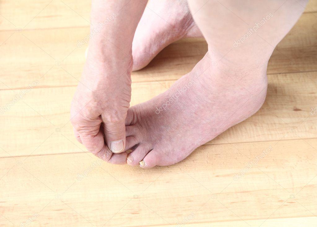 Senior man checking his toes