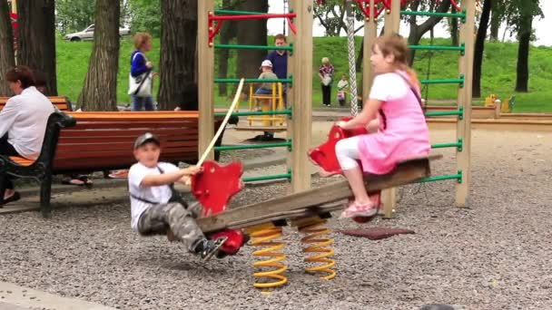 Boy and girl on seesaw