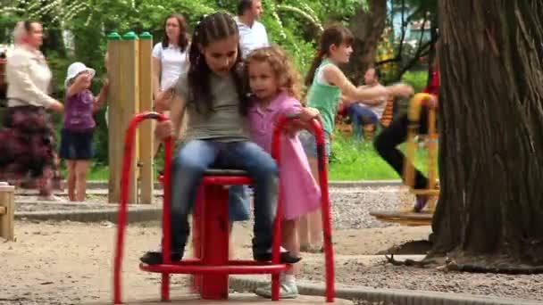 Little girls on the merry-go-round