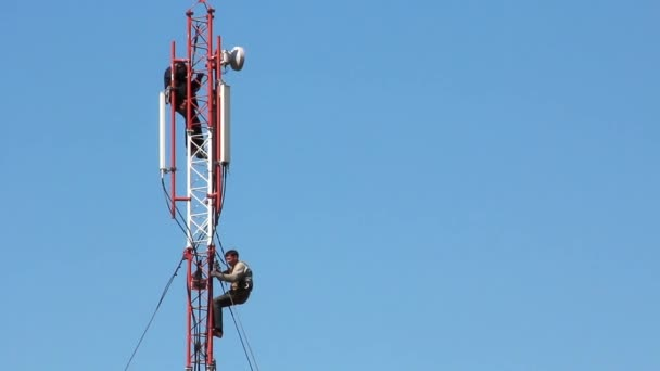 Workers prepare to begin work on an electrical power station tower