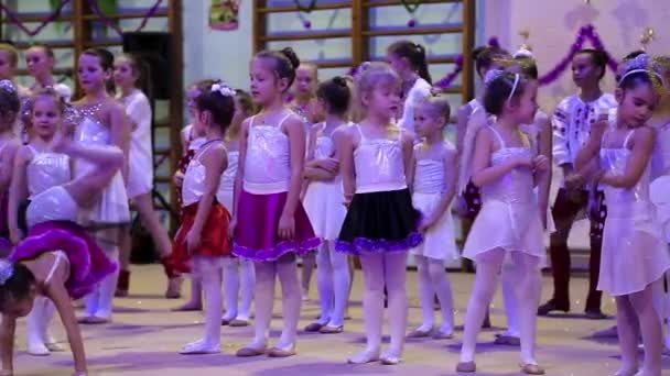 Young girls gymnasts at the New Year performance in school of gymnastics