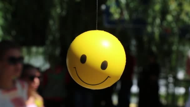 Yellow ball with smile