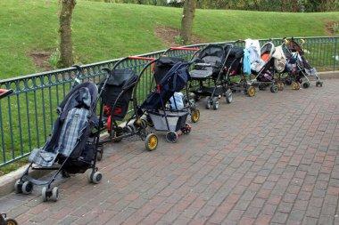 Empty children carriages at autumn park