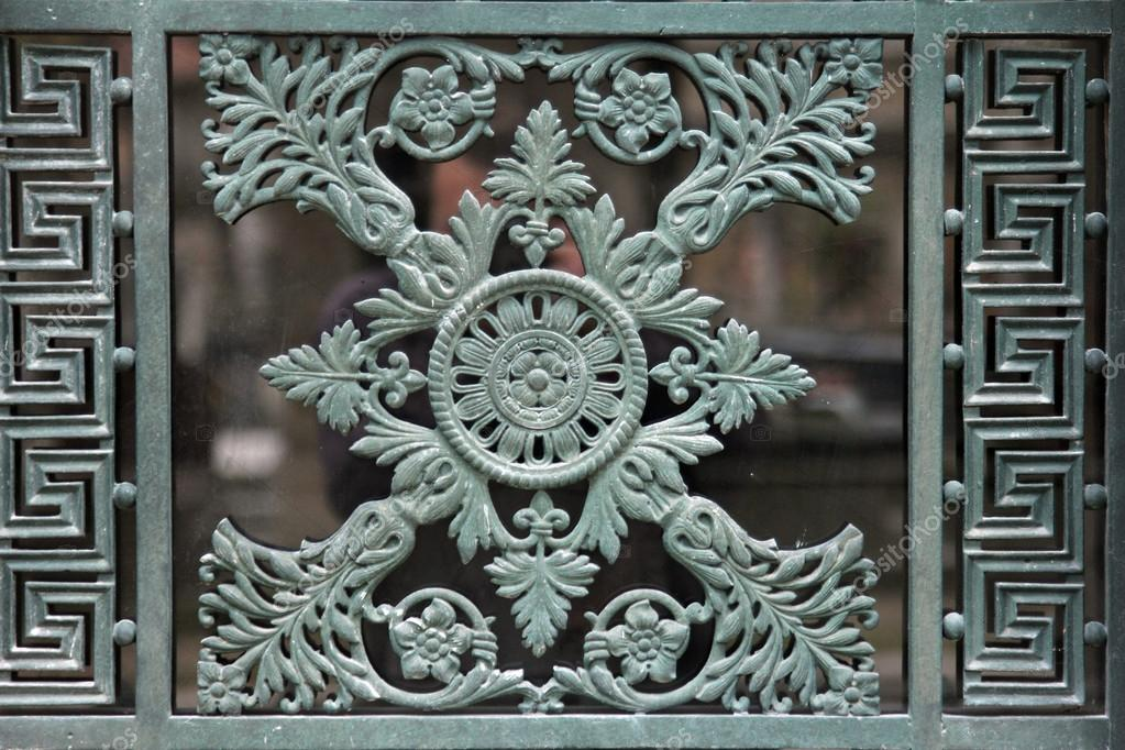 Beautiful ex&le of an ornate Paris tomb door in the Pere Lachaise cemetery. u2014 Photo by zatletic & Ornate tomb door u2014 Stock Photo © zatletic #18083739