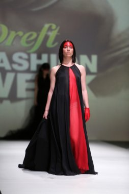 Fashion model wearing clothes designed by Zjena Glamocanin on the Zagreb Fashion Week on May 09, 2014 in Zagreb, Croatia.