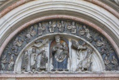 Virgin Mary with baby Jesus. Baptistery. Parma. Italy.
