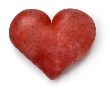 Heart shaped red Potato on a white background. stock vector