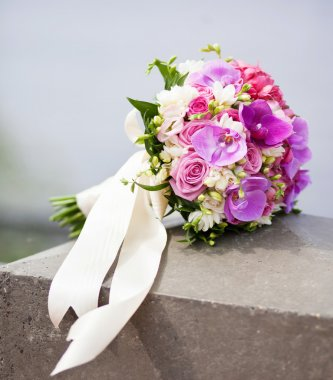 Bridal bouquet with lilac roses and orchids