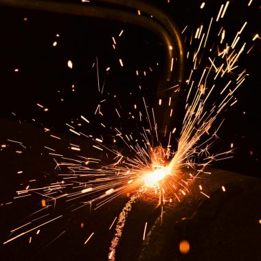 Sparks during welding stock vector