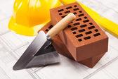 Fotografie Stavební nástroje, cihlové pozadí