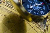Old style compass and map