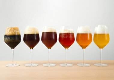 Six glasses with different beers