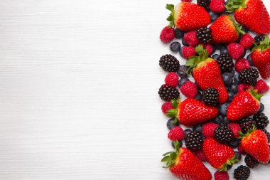 Berries on white Wooden Background