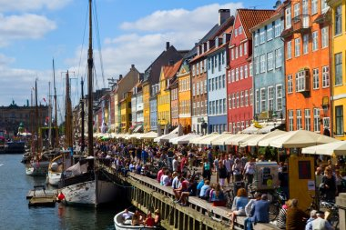 Nyhavn in Copenhagen, Denmark - one of the most popular tourist places of the Danish capital. stock vector