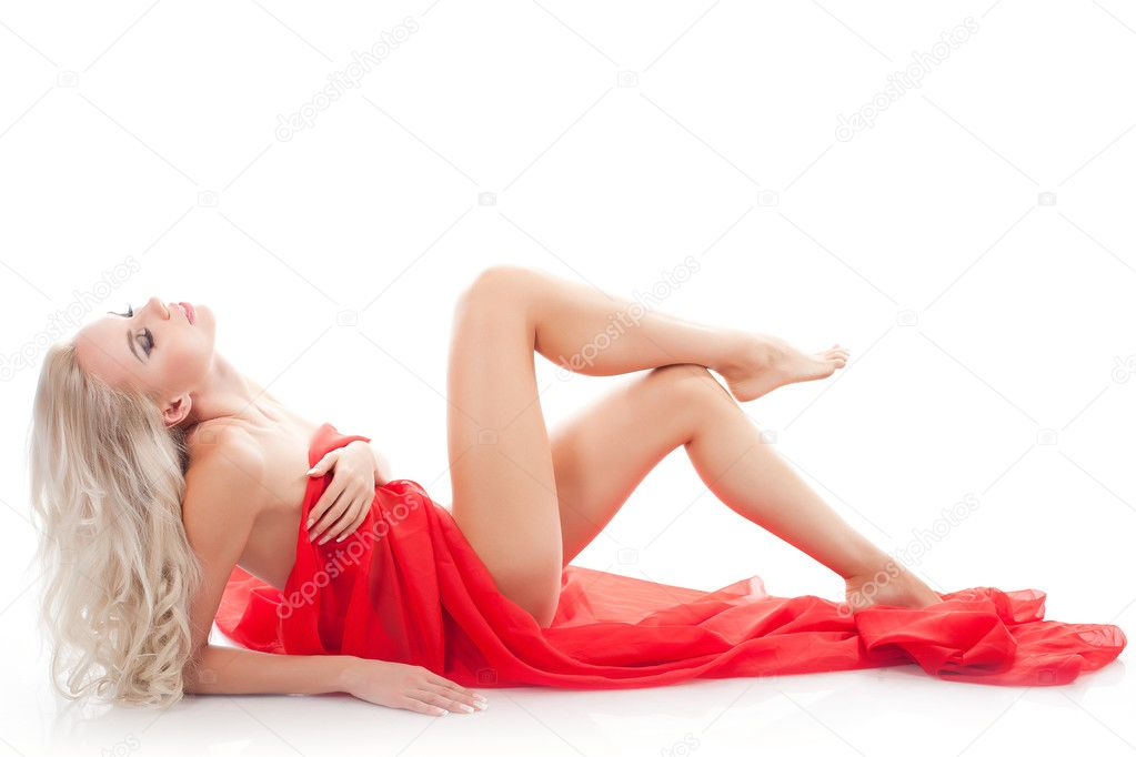 Young sexy blond woman with red fabric on a white