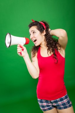 Young woman screaming through megaphone