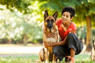 Portrait of woman with german shepherd
