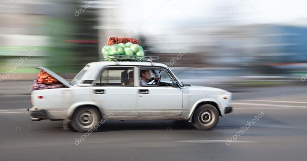 Old car loaded with cabbage and carrots rides through the city s ...