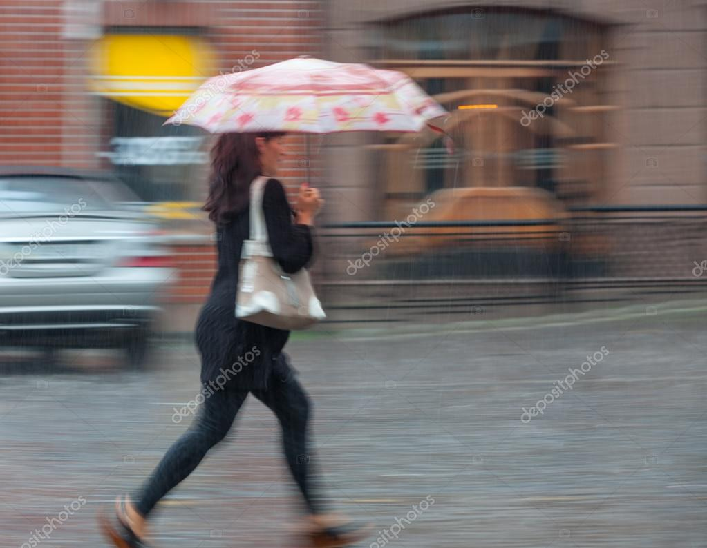 People walking down the street in rainy day
