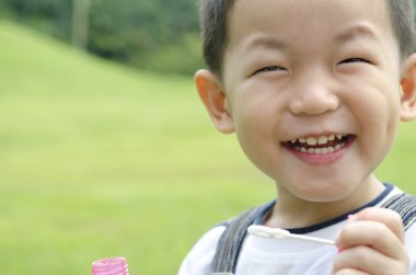 Happy asian kid playing