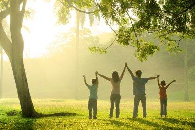 An asian family jumping in joy