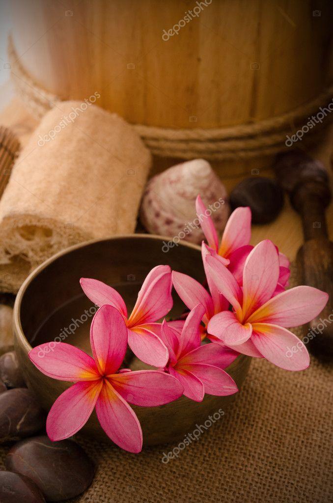 Tropical spa setup with frangipani flower
