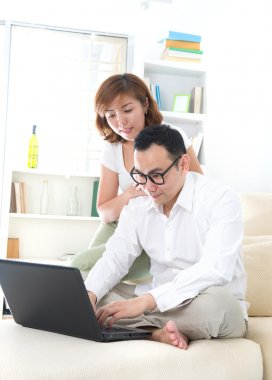 Asian couple doing online shopping