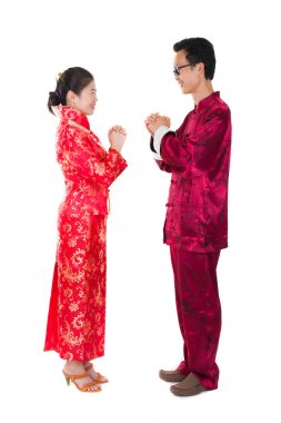 asian couple celebrating chinese new year in traditional clothes