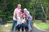 Happy indonesian Family enjoying family time together in the par