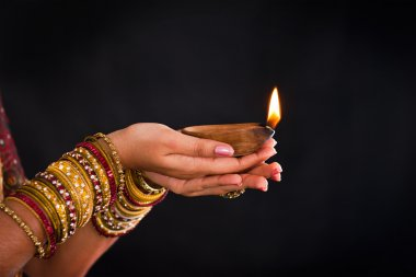 hand holding lantern during diwali festival of lights