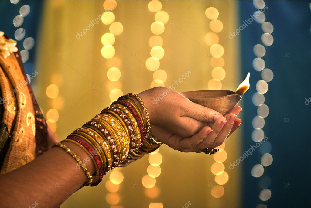 Diwali festival of lights , hands holding indian oil lamp stock vector
