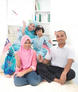 malay family with malaysian flag lifestyle photo