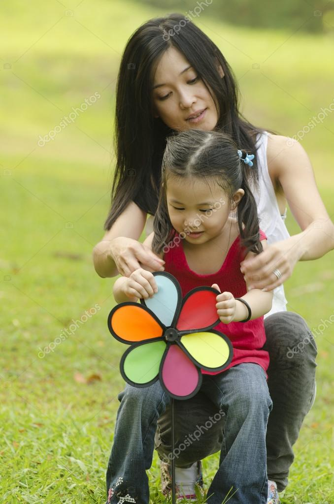 Attractive Mother and daughter spending time together in the par