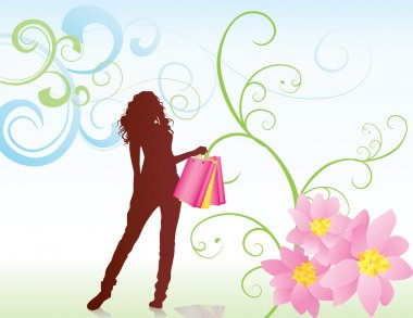 woman with shopping bags and pink flowers