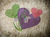 Fotografie srdce na staré zdi