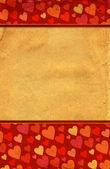 Fotografie Červené srdce na hranicích starých grunge papíru