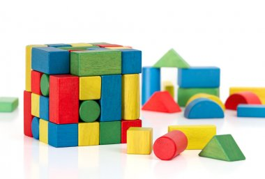 Toy blocks jigsaw cube, multicolor puzzle rubic  pieces on white