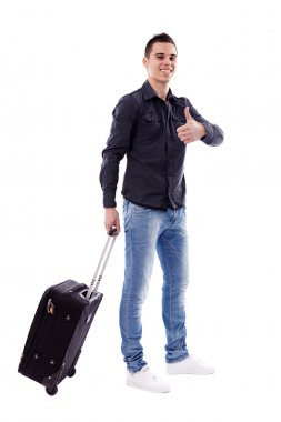 Young traveler carrying his luggage