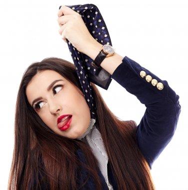 Businesswoman gesturing hanging herself with necktie
