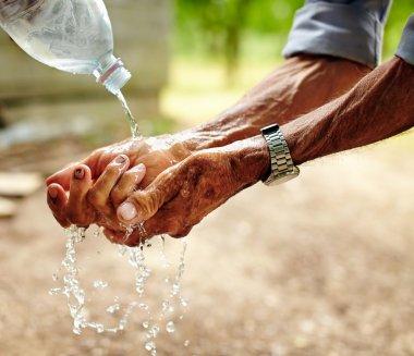 Senior man washing his hands