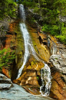 The Apa Spanzurata waterfall in the Latoritei gorge