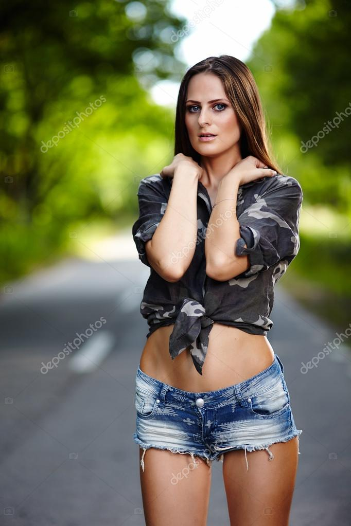 Attractive woman standing on the road