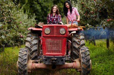 Female farmers driving the tractor