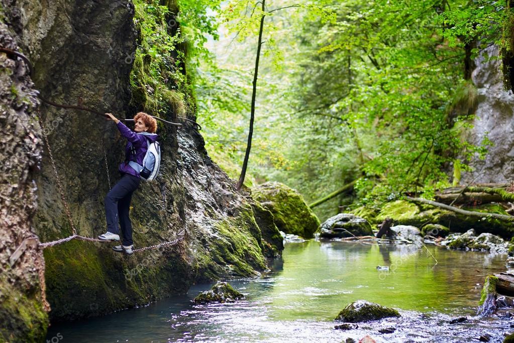 Woman climbing on a mountain wall