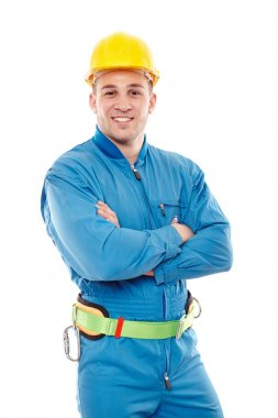 Young handsome worker with arms folded