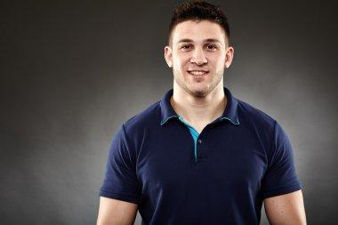 Handsome man wearing a navy blue t-shirt