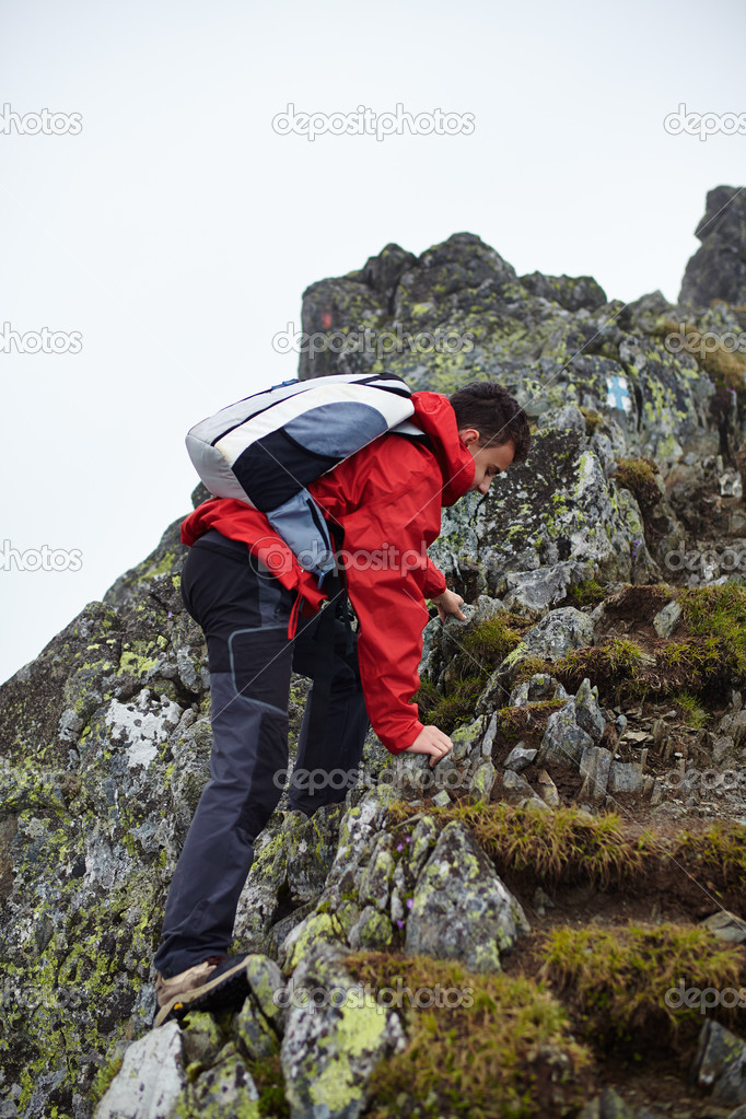 Teenage hiker on mountain