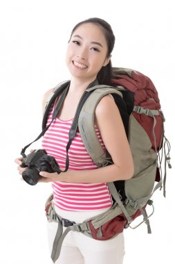 Smiling traveling Asian girl holding a camera