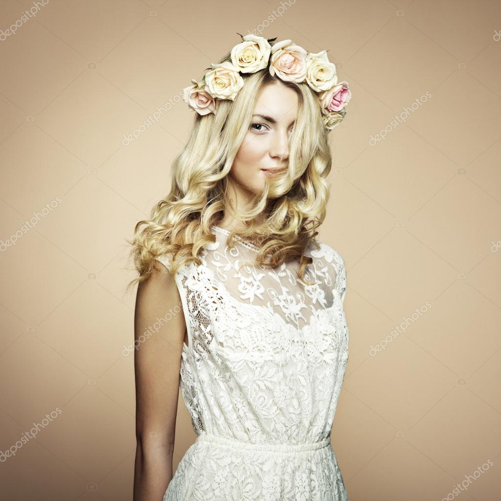 Portrait of a beautiful blonde woman with flowers in her hair portrait of a beautiful blonde woman with flowers in her hair stock photo 18521945 dhlflorist Gallery