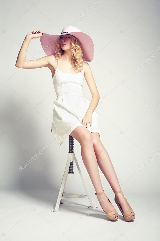 Fashion photo of young magnificent woman in hat. Girl posing. Studio photo. Blonde woman stock vector